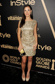 Annika Marks was a classic beauty in this gold brocade dress at the Golden Globe award season celebration.