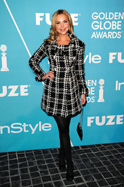 Arielle Kebbel bundled up for the holiday season in a knockout black-and-white plaid winter coat that showcased her slight waist.