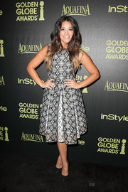 Gina Rodriguez looked vibrant and youthful in her Sebastian Gunawan monochrome print dress during the Golden Globe Award season celebration.