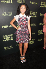 Yara Shahidi teamed her dress with a pair of black-and-white strappy sandals.