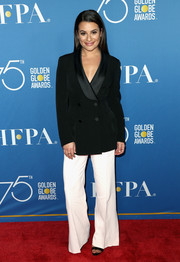 Lea Michele was business-chic in a double-breasted blazer by Ermanno Scervino paired with wide-leg pants at the Television Game Changers panel discussion.