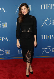 Kathryn Hahn matched her top with a lace-panel pencil skirt.