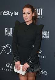 Lea Michele paired a white Edie Parker box clutch with a black mini dress for the Golden Globes 75th anniversary celebration.