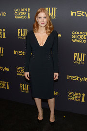Jessica Chastain put on a curvy display in a plunging, figure-hugging LBD by Antonio Berardi at the HFPA and InStyle Golden Globe Award season celebration.