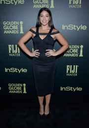 Gina Rodriguez wore a black figure-hugging dress with mesh panels for a chic look