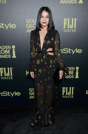 Vanessa Hudgens rocked a black sheer cut-out dress with gold detailing for an edgy, glam look
