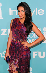 Shay Mitchell added glitz to her gorgeous look with a purple glittery clutch.