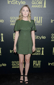 Saoirse Ronan wore an above-the-knee sparkly green dress to the event.