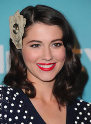 Mary pulled off her vintage look and retro curls with satin red lips.