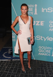 Katie Cassidy shone brightly carrying a silver metallic clutch, which perfectly matched her silvery stilettos.