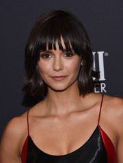 Nina Dobrev looked sweet and youthful wearing this short hairstyle with bangs at the Golden Globes 75th anniversary celebration.