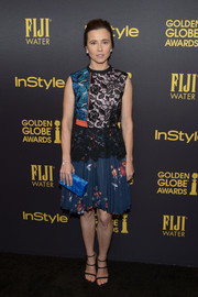 Linda Cardellini attended the HFPA and InStyle Golden Globe Award season celebration wearing a Self-Portrait dress featuring a tricolor lace bodice and a pleated floral skirt.