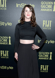 Mary Holland wore a long-sleeved black crop top with a high-neckline for her look