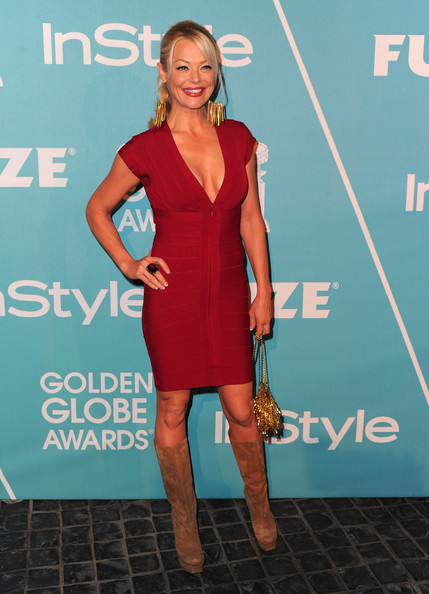 Charlotte Ross looked red hot in suede platform boots. She rocked the knee high boots with a fitted bandage dress.