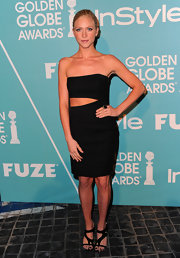 Brittany Snow paired her sexy black cut out dress with strappy black sandals. Sleek hair and minimal accessories, save for a black cocktail ring, give Brittany a simply sultry look.