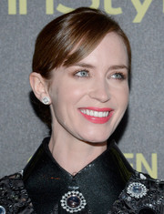 Emily Blunt looked sweet in a bright pink lipstick