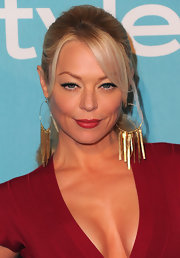 Charlotte Ross spiced up her ponytail with gold hoop earrings complete with decorative chains.