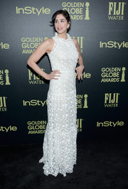 Sarah Silverman donned a floor-length white laced dress with a ruffled neckline.