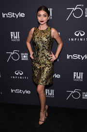 Sarah Hyland polished off her elegant look with a pair of gold and black Giuseppe Zanotti sandals.