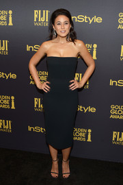 Emmanuelle Chriqui showed off her slender physique in a fitted, strapless LBD at the HFPA and InStyle Golden Globe Award season celebration.