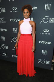 Issa Rae paired her top with a red maxi skirt, also by Brandon Maxwell.