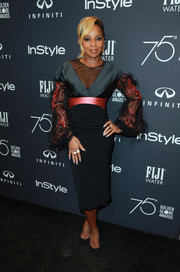 Mary J. Blige went ultra sophisticated in a black Bibhu Mohapatra cocktail dress with a coral satin waistband and feathered sleeves at the Golden Globes 75th anniversary celebration.