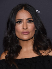 Salma Hayek looked charming with her long center-parted curls at the Golden Globes 75th anniversary celebration.