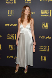 Michelle Monaghan was modern and chic in an Off-White satin slip dress with a pleated panel during the HFPA and InStyle Golden Globe Award season celebration.