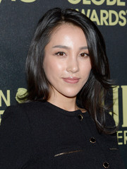 Jane Wu styled her hair in a side-parted medium layered cut