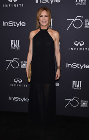 Felicity Huffman looked sophisticated in a flowy black halter dress at the Golden Globes 75th anniversary celebration.