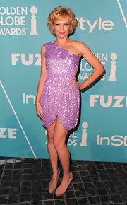 Emily Bergl resembled a figure skater in nude platform pumps, paired with a lavender sequined mini dress.