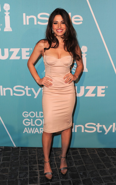 Sarah Shahi went for full on va va voom in silver platform sandals. She paired the sexy heels with a blush colored cocktail dress.