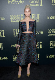 Cara Santana wore a long-sleeved dress that had a major cut-out on the bodice and a full skirt