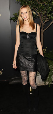 Heather Graham wore a black corset top with a textured mini and floral fishnets at the Hollywood Reporter party.