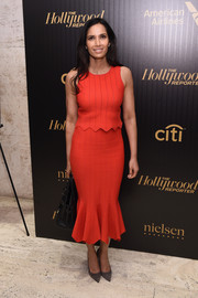 Padma Lakshmi paired her top with a matching red trumpet skirt.
