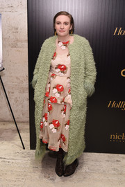 Lena Dunham attended the Hollywood Reporter's 35 Most Powerful People in Media event wearing a fluffy avocado-green coat over a floral dress.