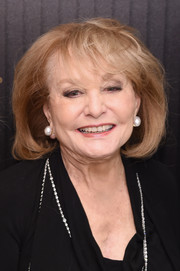 Barbara Walters styled her hair into a teased bob with wispy bangs for the 2016 35 Most Powerful People in Media event.