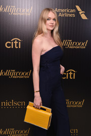 Lindsay Ellingson went for ultra-modern styling with this boxy yellow croc-embossed purse at the Hollywood Reporter's 35 Most Powerful People in Media event.