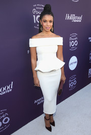 Susan Kelechi Watson paired her lovely dress with burgundy ankle-strap pumps by Pollice Lee.