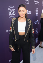 Shay Mitchell accessorized with a classic black suede clutch by Chanel at the Hollywood Reporter's 2017 Women in Entertainment Breakfast.