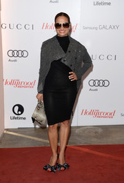 A pair of bow-adorned black satin sandals finished off Judy Reyes' look in sweet style.