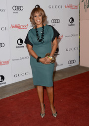 Gayle King complemented her dress with a pair of stylish python pumps.