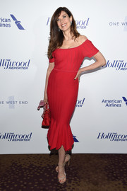 Carol Alt's gold slim-strap sandals and red dress were a very chic pairing!