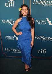 Auli'i Cravalho attended the Hollywood Reporter 5th Annual Nominees Night wearing a blue ruffle halter dress.
