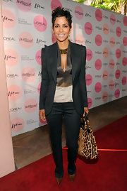 Halle Berry carried an of the moment leopard print tote on the red carpet. She paired the trendy bag with a pinstripe suit and her signature cropped 'do.