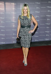 Chelsea Handler was ladylike luxe on the red carpet. The funny gal accessorized her look with gray suede platform pumps.