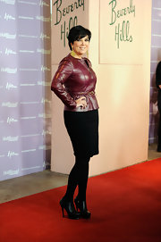 Kris Jenner showed off her waist at the Women in Entertainment breakfast with a collarless maroon leather peplum jacket and a fitted pencil skirt.