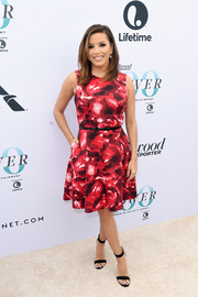 Eva Longoria chose simple black ankle-strap sandals by Gianvito Rossi to finish off her look.