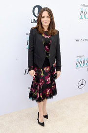 Tina Fey wore a black blazer over a floral frock when she attended the Hollywood Reporter's Women in Entertainment Breakfast.