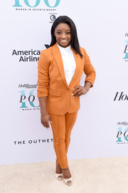 Simone Biles completed her outfit with a pair of cream-colored peep-toe pumps by Badgley Mischka.